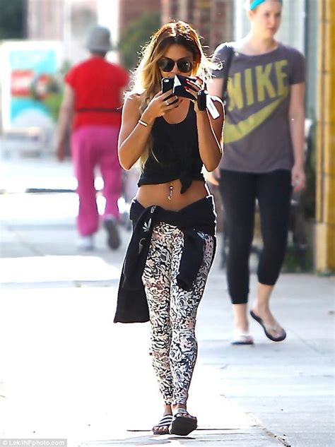 Vanessa Hudgens displays her toned, bejeweled stomach in a