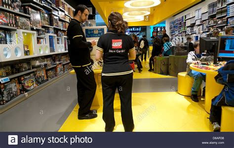 Staff wearing Lego logo uniform viewed from the back in a